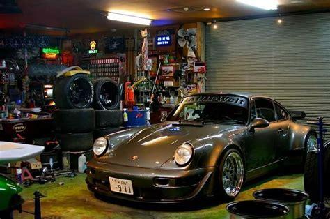 rwb porsche in a fairly unorganized garage but it makes