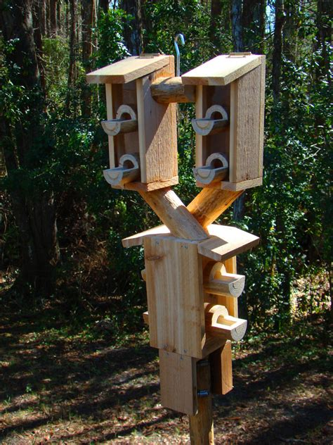 outdoor bird house feeder looks like 3 wooden birdhouses but