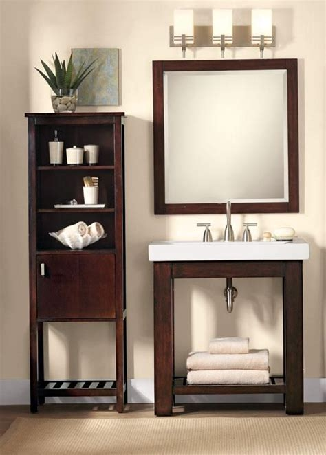 a modern single bath vanity with open shelving gives this