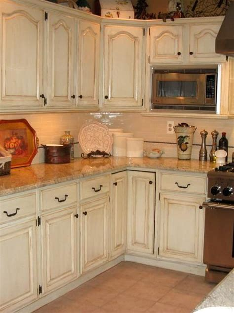 painting kitchen cabinets cream hand painted and distressed kitchen cabinets similar to