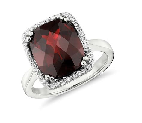 garnet and halo cushion cut ring in 14k white gold