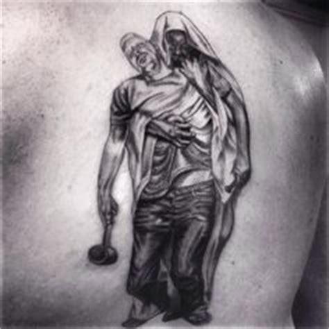 tattoo of jesus holding a man tattoo portfolio on pinterest cover tattoos tattoo ink