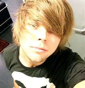 Us back to his high school days where he rocked a very thick fringe