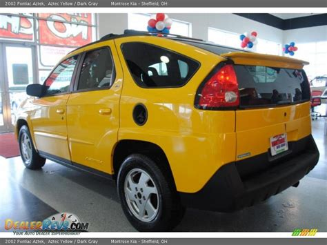 pontiac aztek yellow 2002 pontiac aztek aztec yellow dark gray photo 4