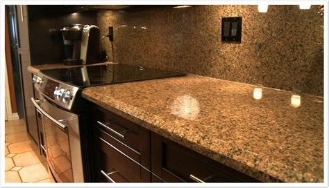 Brown Kitchen Cabinets With Granite Countertops by Desert Brown Granite With White Cabinets Roselawnlutheran