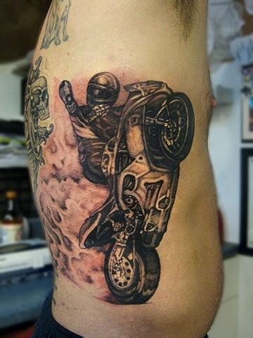 awesome racer in sports bike tattoo on ribs tattooimages biz