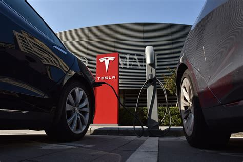 tesla outside tesla stock earnings ubs sees cash running out in 2018