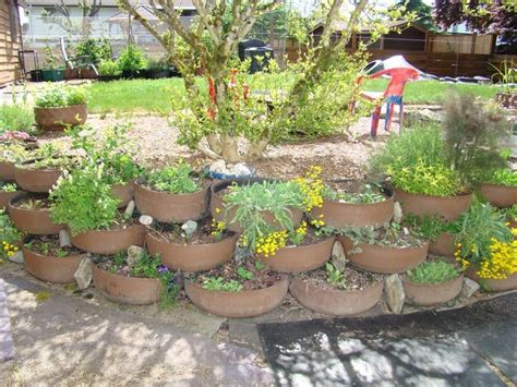 Tires Planting Retaining Wall Tire Tops Are Cut Off And Tire Garden Ideas