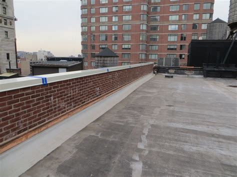 parapet wall roof parapet scupper an opening in a wall or parapet for