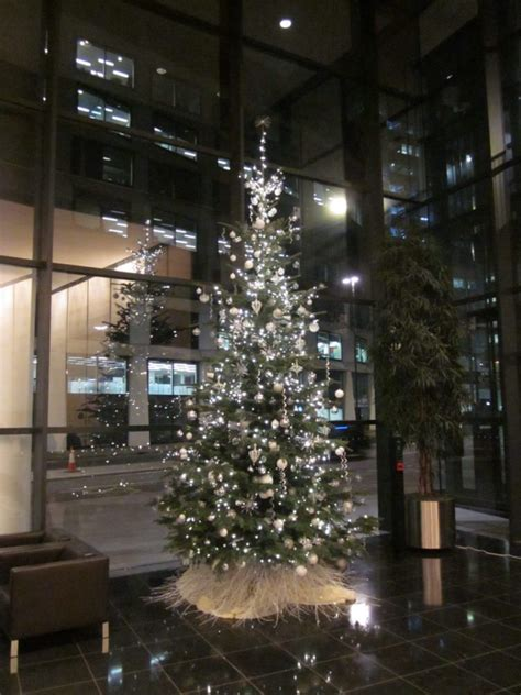 corporate christmas tree silver and white flowers by
