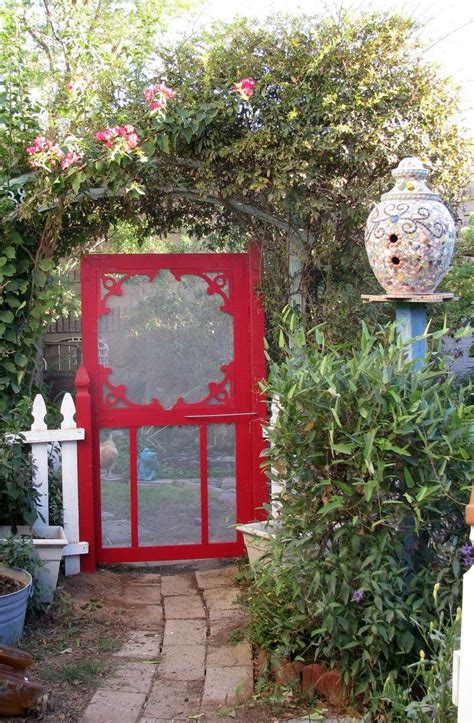 paint a screen door a bright color and use it as a garden gate house gardens