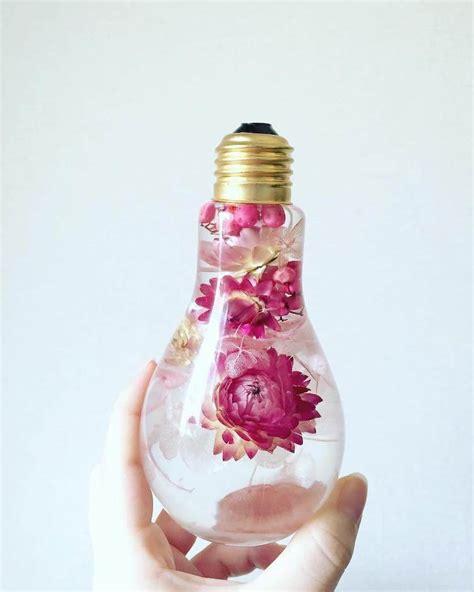 flowers in light bulbs beautiful flowers inside light bulbs suspended in