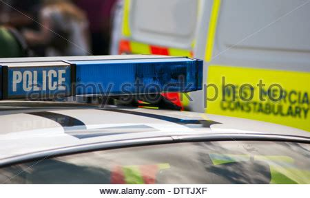 bars on top of car the blue light on top of a a police car flashing at the