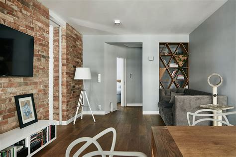 exposed brick renovated krakow apartment showcases beauty of exposed