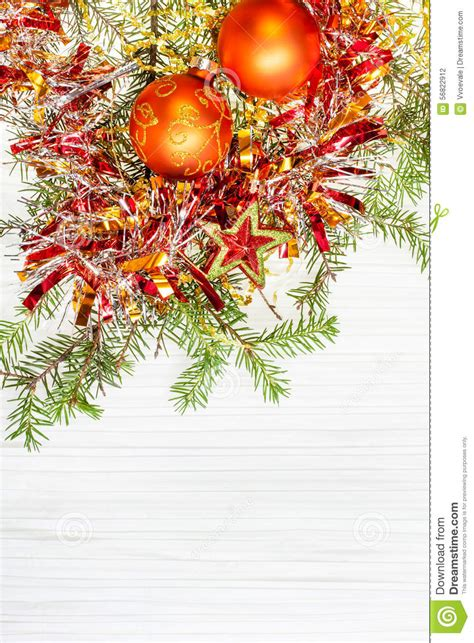 orange baubles tree and two orange baubles and twig on paper stock
