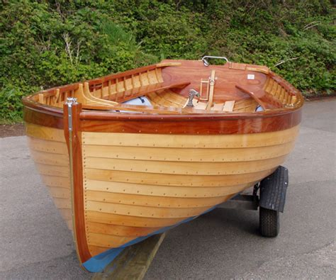boat building europe fowey river class dinghy wooden clinker varnished 15