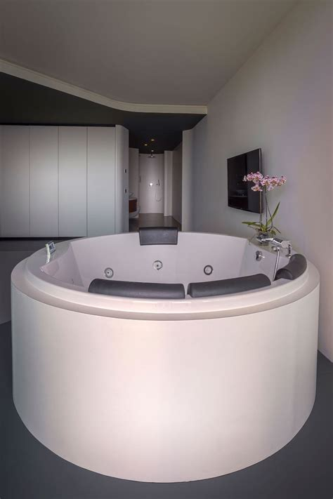 master bedroom with jacuzzi tub rotterdam penthouse with a perfect flow and stunning views