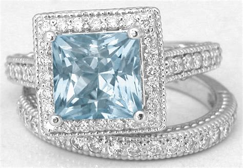halo engagement ring with princess cut aquamarine
