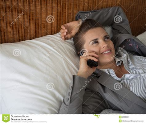 woman talking on cell phone in bed stock image f006 6900 business woman talking cell phone in hotel room stock