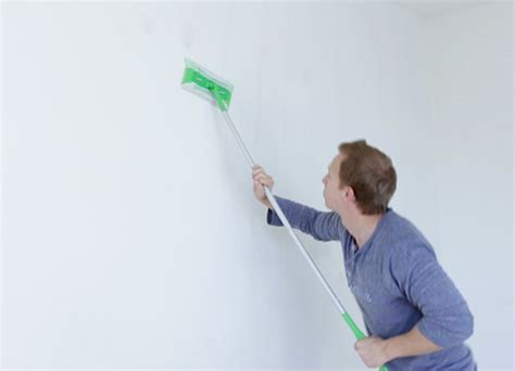 how to clean painted bathroom walls woman mixing paint alternatives to tsp for cleaning the walls before painting ehow