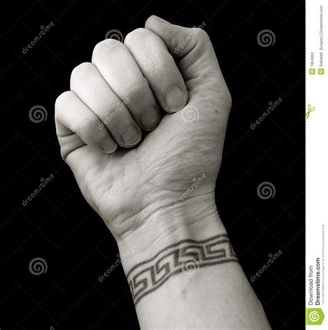 xs tattoo prices fist with wrist tattoo in greek key pattern over black