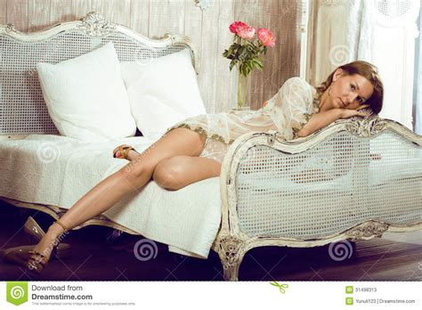 lay on the bed beauty woman in bed in white interior stock photos image