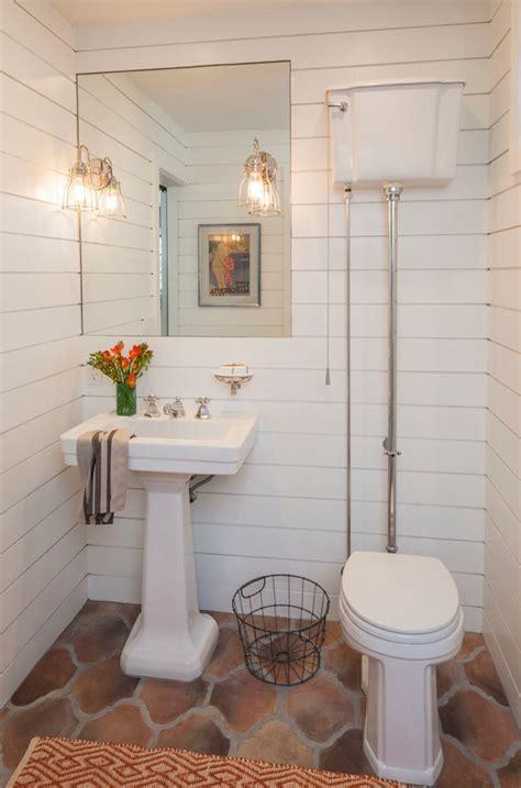 pull chain toilet Powder Room Mediterranean with high tank