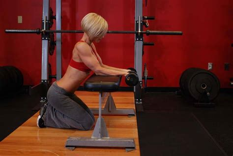 knee on bench dumbbell palms up dumbbell wrist curl over a bench exercise guide