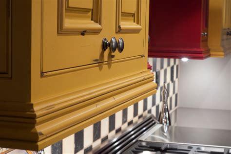 mustard kitchen cabinets distressed rustic light rail mustard yellow cabinets