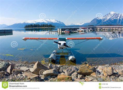 tiny boat cartoon man afloat in tiny boat on currency royalty free stock
