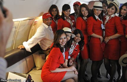 airasia uniform airasia chief on revealing crew uniform crew designed