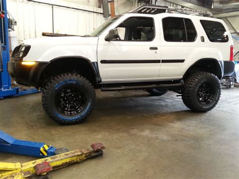 nissan xterra lift kit 02 nissan xterra with 3 quot suspension and 2 quot body lift just