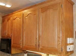 Painting And Glazing Kitchen Cabinets by Paint And Knobs To Complement Honey Oak Cabinets Counter