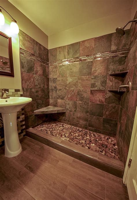 river rock bathroom river rock shower and wood grained tile floor bathroom