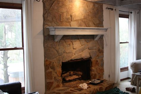 how to stone a fireplace erin s art and gardens painted stone fireplace before and