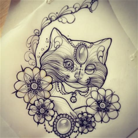 tattoo cat in frame winking gem decorated cat portrait in flowered frame