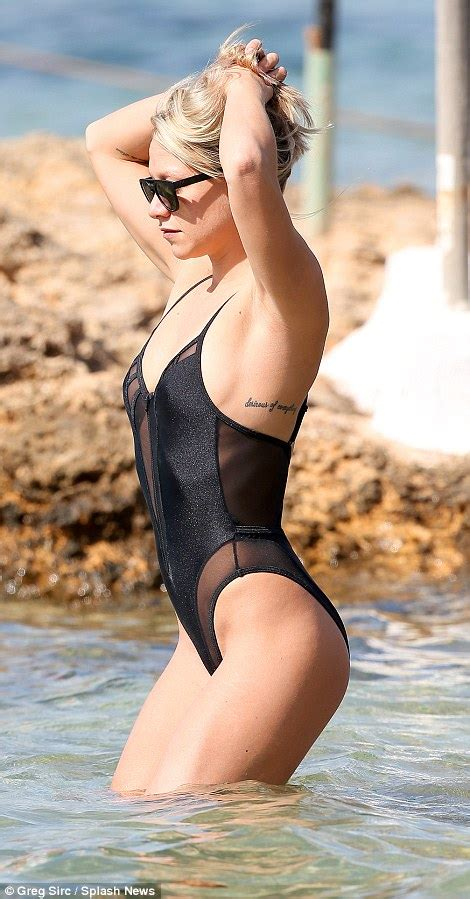 jetski 2e hands chloe madeley shows off her gym honed figure in swimsuit