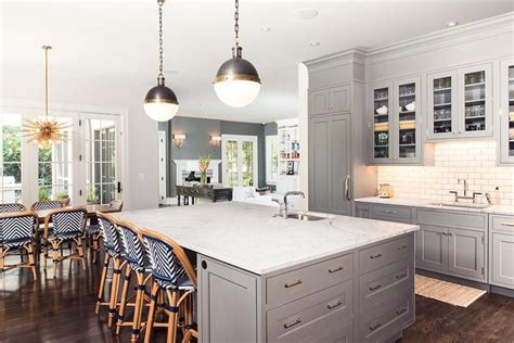 gray kitchen features gray shaker cabinets paired