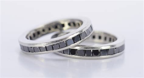 lot 795 pair platinum black eternity rings