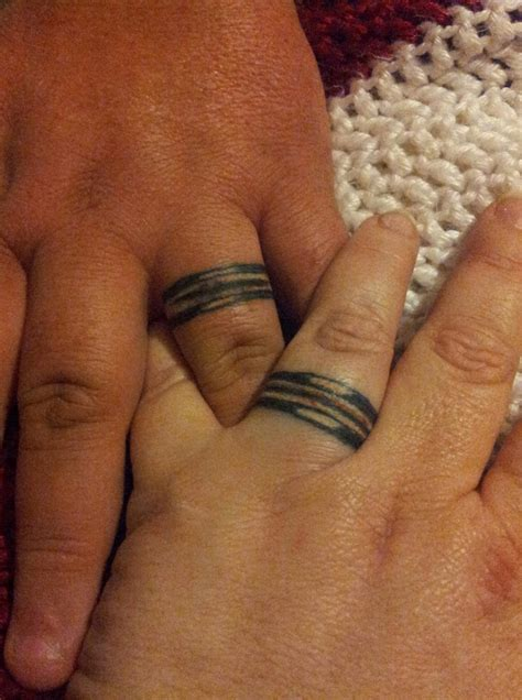 tattooed couple wedding wedding ring tattoos designs ideas and meaning tattoos