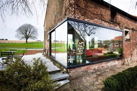 rustic farmhouse in belgium gets a glassy contemporary