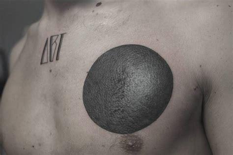 tattoo on chest left side blackwork circle tattoo on the left side of the chest
