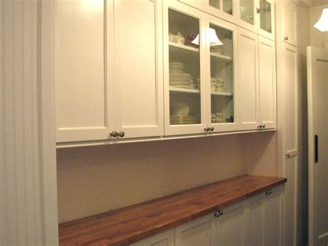 White Pantry by Kitchen Designs White Pantry Butcher Block Countertops