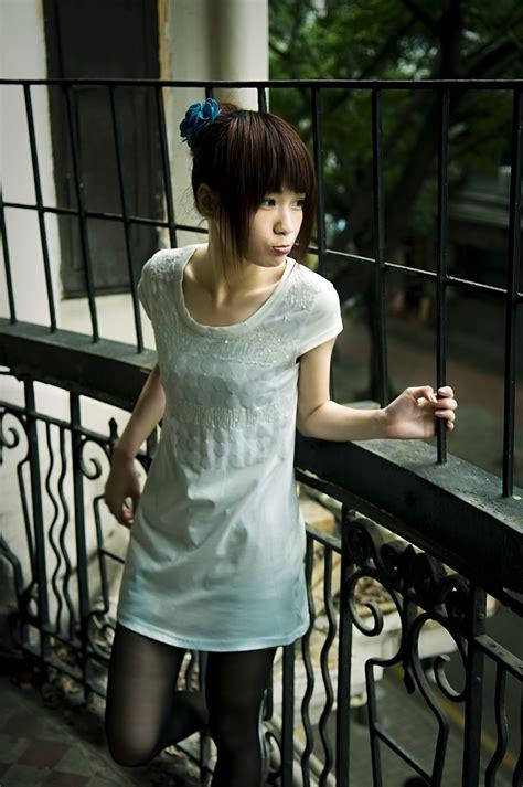 girl pretty  stock photo  beautiful chinese girl posing   fence