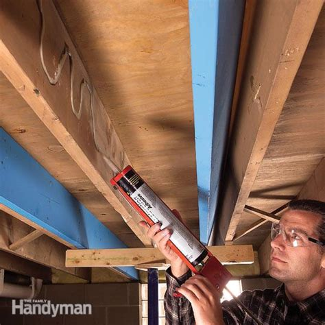 Repair Floor Joist How To Make Structural Repairs By Sistering Floor Joists The Family Handyman