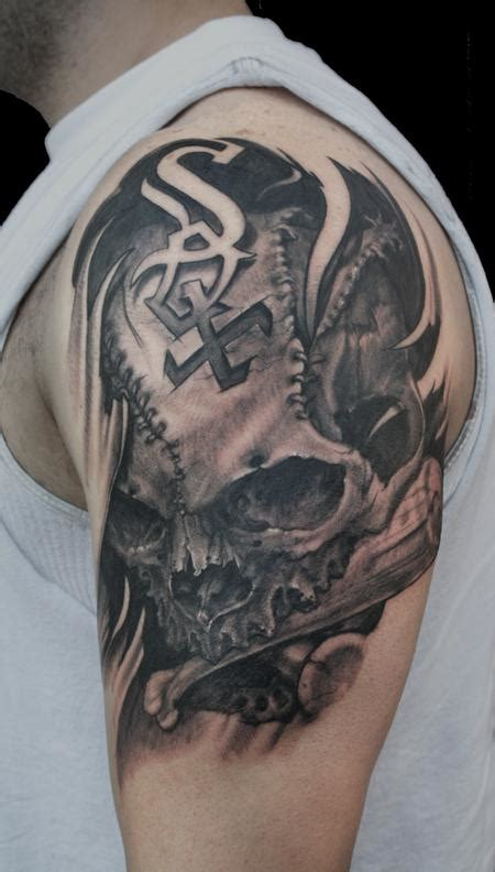 tattoo shoulder skull ripped skin skull tattoo on man left shoulder