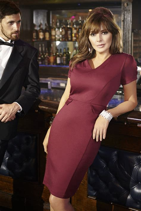 Carol Vorderman flaunts her curves in form fitting party
