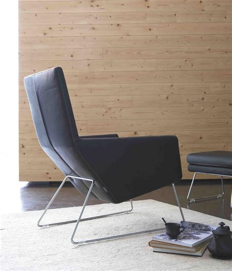 armchair with footstool don armchair with footstool lounge chairs from label