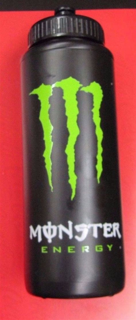 energy drink bottles bottle black and black water on