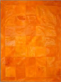 Orange Modern Rugs Orange Border Cowhide Rug From The Cowhide Rugs Collection At Modern Area Rugs